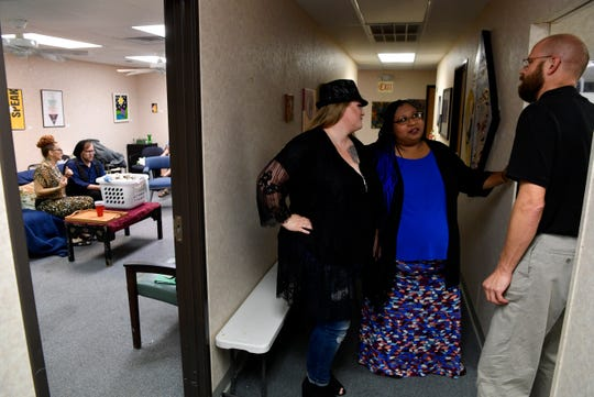 "Mandi Rhodes, left, Tosha Flores and Paul Mathis converse in a hallway of the rehearsal space while Gloria Ramirez (Ann) and Tyler Sparks (Martin) rehearse a scene on a couch for ""Square One,"" a production original to the Underground Overground Theatre Company."