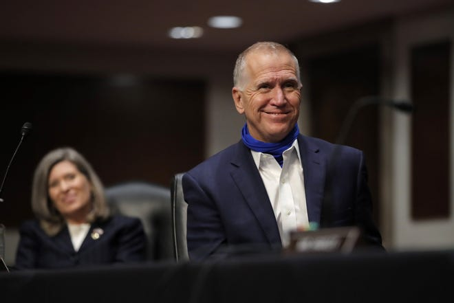 Sen. Thom Tillis in this June 11 photo in Washington, D.C., is wearing a neck gaiter, a scarf-like garment that he pulls over his mouth and nose to serve as a face mask to avoid spreading the coronavirus. On Monday, Tillis urged North Carolinians to wear masks to quell the COVID-19 disease.