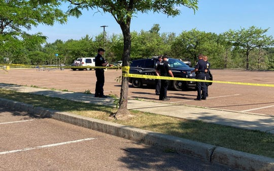 Officers with the Williston Police Department gather in the Walmart parking lot in the town where a body was discovered in the white van in the background on Tuesday, June 23, 2020.