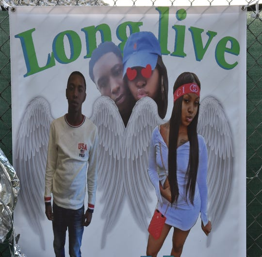 A banner shows the images of Jaheem Plummer and Mazyah Thomas, two Camden 17-year-olds who died in an early-morning crash in the Cramer Hill neighborhood.