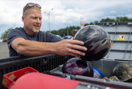 Gary Hurley of Wrightstown loads equipment into his truck outside Thunderbird Lanes.