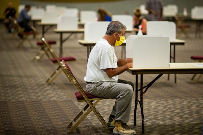 People vote in the Kentucky Primary election at the Northern Kentucky Convention Center on Tuesday, June 23, 2020 in Covington, Kentucky.