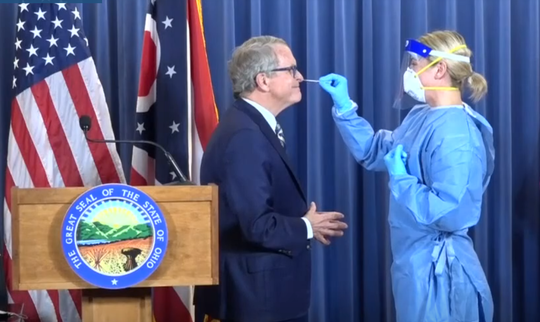 Gov. Mike DeWine is tested for the coronavirus during a briefing on the state's COVID-19 response on June 23, 2020.