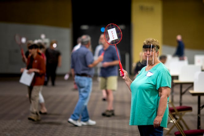 Election officials use badminton rackets to direct people to voting stations during the Kentucky Primary election at the Northern Kentucky Convention Center on Tuesday, June 23, 2020 in Covington, Kentucky.