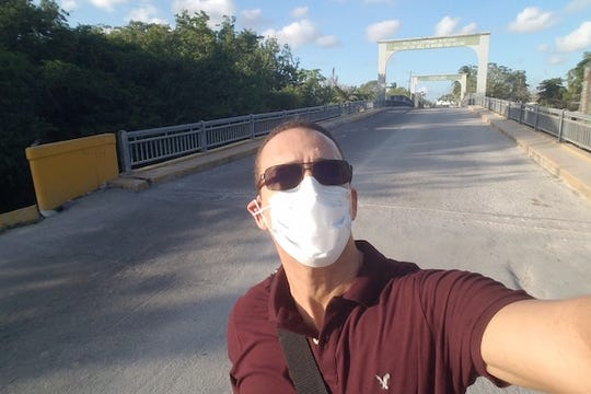 Dr. Harold Young crossing the border between Mexico and Belize.