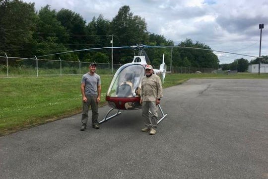 Ryan Erb, left, and instructor Donald Stanton smile after Erb's first solo flight.