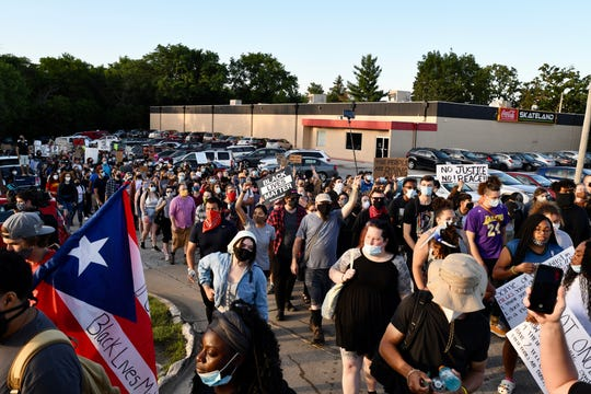 Protesters leave the Skateland parking lot to march towards Interstate 80. Black Lives Matter and Iowa Freedom Riders planned statewide action where protests across the state would block interstates. However, the crowd met protesters at the interchange, so the demonstrators marched through downtown Des Moines on Monday, June 22, 2020.