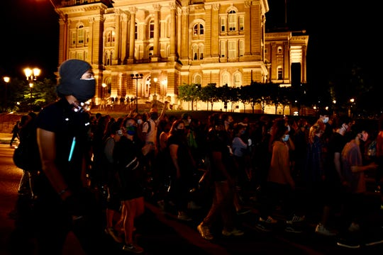 Protesters march past the Iowa State Capitol after Des Moines on Monday, June 22, 2020. Protesters planned to block traffic on the interstate but instead marched through downtown Des Moines.