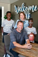 The Porter family is pictured at their church Friday, June 12, 2020, in Newcastle, Okla. From left are Timothy, Matt, Julie and Paul. The family lives in a small, mostly white town.