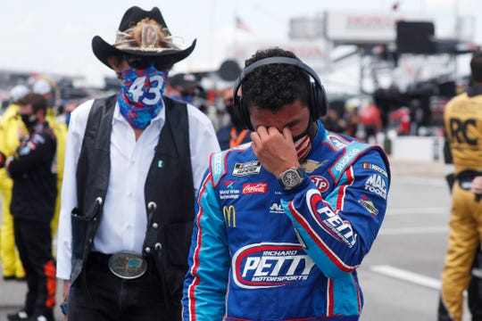 Driver Bubba Wallace, right, is overcome with emotion as he and team owner Richard Petty walk to his car in the pits of the Talladega Superspeedway prior to the start of the NASCAR Cup Series auto race at the Talladega Superspeedway in Talladega Ala., Monday June 22, 2020.