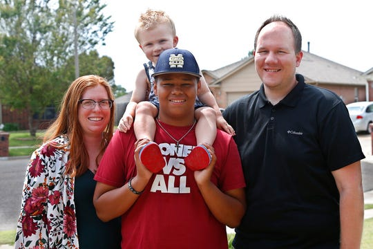 The Dunn family is pictured outside their home Friday, June 12, 2020, in Oklahoma City. From left Sarah Dunn, Cooper Dunn, Izzy Simons and Josh Dunn. Sarah Dunn, who grew up in rural Kansas, has learned much about race since she and her husband, Josh, took custody of Izzy six years ago.
