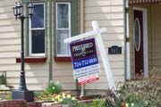 This April 16, 2020 photo shows a real estate company sign that marks a home for sale in Harmony, Pa. New homes sales rose a surprisingly strong 16.6% in May.