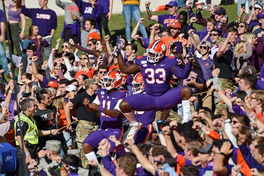 Ruke Orhororo (33), a former River Rouge standout, had five tackles (1.5 for loss) in nine games as a freshman at national runner-up Clemson.