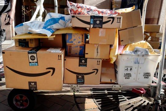 In this Oct. 10, 2018, file photo, Amazon Prime boxes are loaded on a cart for delivery in New York.