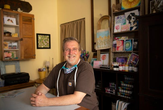 """Ken Oliver of Newburgh, Ind., and his Downtown Newburgh community refuse to let the actions of one """"cowardly"""" individual early Monday morning scare him into silence and will continue voicing his anti-discrimination message. A hate sign targeting his sexuality was posted on his door condemning his displaying a rainbow flag on his door to celebrate Pride month."""