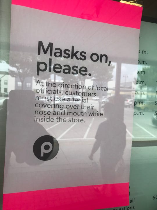 A sign on the door of the Publix Super Market at McBee Station in Greenville on the first day Greenville's mask-wearing requirement went into effect.