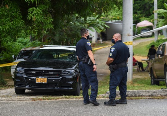 Guam Police Department officers are shown at the scene of a death investigation on Chalan Tatujan in Agana Heights, June 23, 2020. Anthony Gregory Mendiola was arrested in the case.