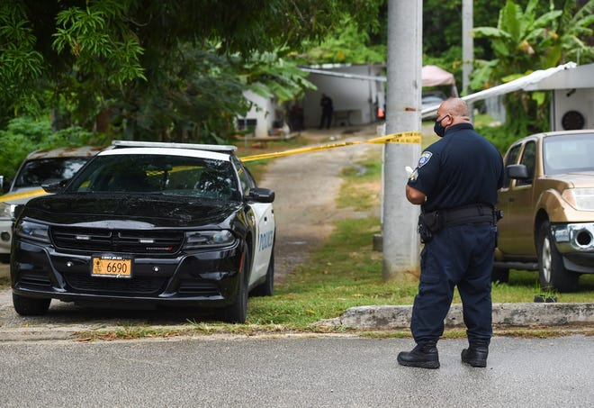Guam Police Department officers at the scene of a death investigation on Chalan Tatujan in Agana Heights, June 23, 2020.