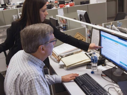 """IndyStar reporter Marisa Kwiatkowski works with investigations editor Steve Berta in a scene from Netflix documentary """"Athlete A."""""""