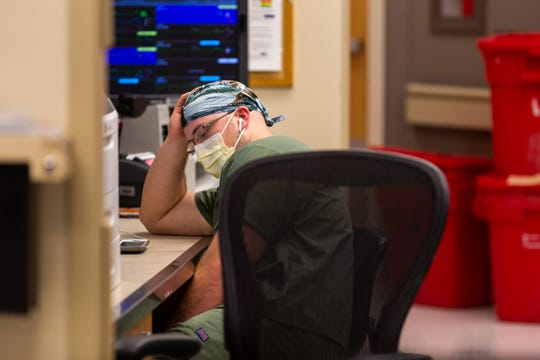 Registered nurse Kevin Marchant takes a moment to breathe in the MICU, where very ill COVID-19 patients receive care at the University of Mississippi Medical Center.