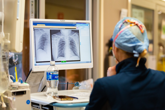 Dr. Jessie Harvey at the University of Mississippi Medical Center closely examines a COVID-19 patient's lung scans to track progression and severity of the disease.