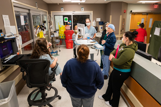 Teams comprised of attending physicians; residents and fellows; pharmacists; social workers; interns; and nurse practitioners make daily rounds in the medical ICU at the University of Mississippi Medical Center.