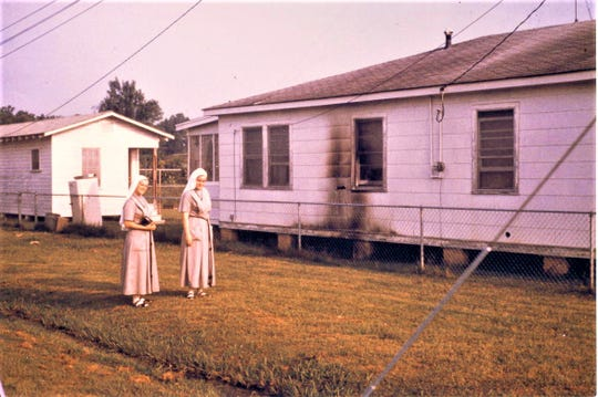 Two nuns stand outside the charred outer wall of the home of Rev. Anthony White in Ferriday in 1965 following the Klan's unsuccessful attempt to destroy the home with a bomb. White was a member of the Ferriday Deacons for Defense and Justice.