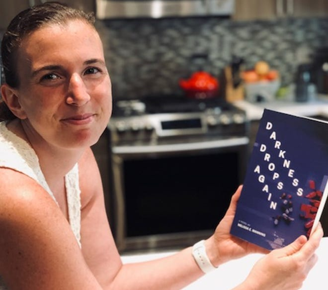 """Melissa Manning, a 1998 St. Peter's High School graduate, has written her first legal thriller, """"Darkness Drops Again."""" Submitted photo."""