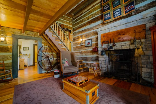 The inside of the log home is a step back in time, allowing families the opportunity to relax and reinvigorate.  Credit: Jason Joseph