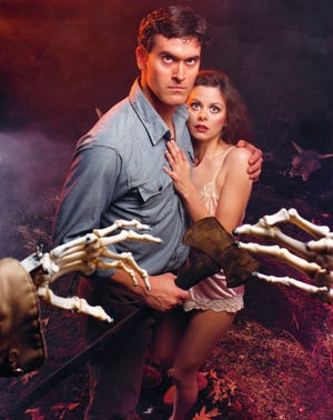 """Bruce Campbell is grasped at by flesh and by bones in a publicity still for """"The Evil Dead."""""""