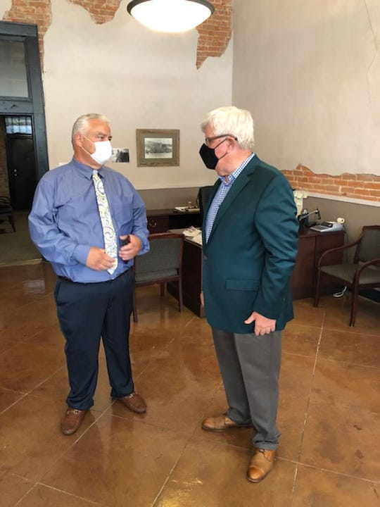 Public Service Commissioner Foster Campbell, at right, speaks with Ringgold Mayor Milton Vining during Campbell's announcement in Monroe of $1 million in PSC grants for Energy Efficiency in Local Governments of Northeast Louisiana.  Ringgold received $75,000 to install efficient LED lighting in city buildings.