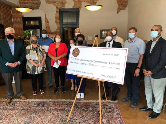 Public Service Commissioner Foster Campbell, at left, stands with representatives of Northeast Louisiana local governments during his announcement in Monroe of $1 million in grants for energy-efficiency improvements.  From left are Campbell, Haynesville Mayor Beverlee Killgore, Glenn Henderson of the Concordia Parish School Board, Haynesville Councilmember Valinda Webb, Mrs. Milton Vining and husband Mayor Milton Vining of Ringgold, Courtney Tannehill of the Town of Wisner, Grambling Mayor Edward Jones, East Carroll Parish Sheriff Wydette Williams, and Stephen Dupont and Sheldon Jones of the Richland Parish School Board.