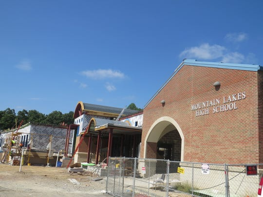 Construction continues on a 23,000-square-foot addition and other improvements to Mountain Lakes High School.  June 23, 2020.