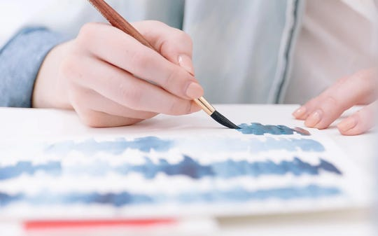 Create a Fourth of July-themed painting via video demonstration from a local artist.