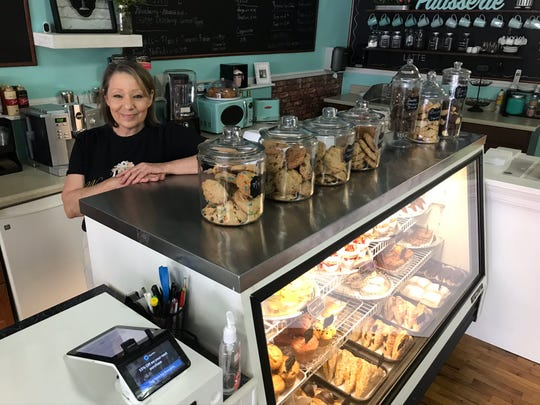 Nonie's Bakery owner Cindy Marshall stands behind the case where she will have soft-serve ice cream soon. The shop is in downtown Murfreesboro.