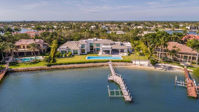 An elegant waterfront property in the ultra-luxe enclave of Port Royal sold on June 18 for $19.8 million, making it a record sale in Southwest Florida this year.