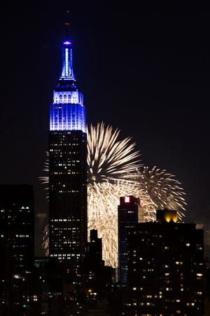 Fireworks light up the Empire State Building along the Manhattan skyline during Macy's 37th Annual Fourth of July fireworks show July 4, 2013.