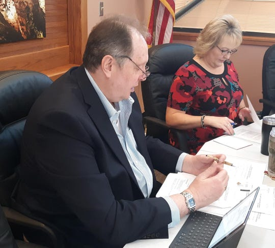 Eddy County Manager Allen Davis (left) and District 5 Eddy County Commissioner Susan Crockett look over some items during the June 23, 2020 Eddy County Board of County Commissioners meeting in Carlsbad.
