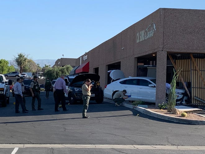 A Riverside County sheriff's deputy responding to a reported alarm at a gun shop in Palm Desert late Monday fatally shot an armed suspect who exited the business, a sheriff's department spokeswoman said. This photo was taken the next morning.
