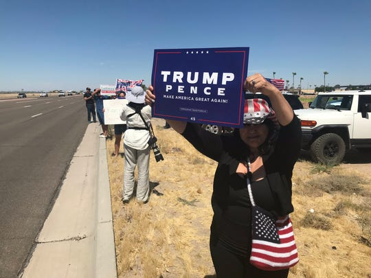 Dozens of supporters and a few protesters are braving the intense heat awaiting the arrival of President Trump in Yuma on June 23, 2020.