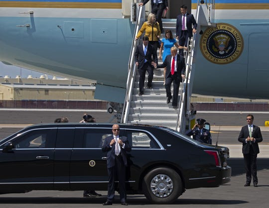 President Donald Trump exits Air Force One at Phoenix Sky Harbor International Airport for his Students for Trump rally on June 23, 2020. Trump arrives with Rep. Debbie Lesko, R-Ariz., left, and Sen. Martha McSally, R-Ariz.