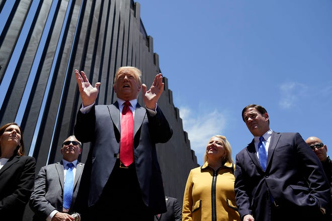 President Donald Trump tours a section of the border wall on  June 23, 2020, in San Luis.