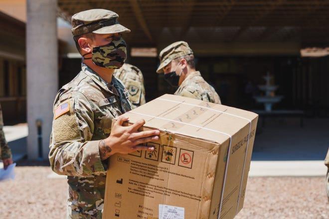 Arizona National Guard overseeing PPE distribution.