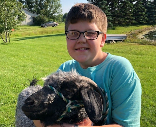 Johnathon Larson, 11, shows goats through his participation 4-H. Larson is a member of Extraordinary Explorers, a 4-H group for students with special needs.
