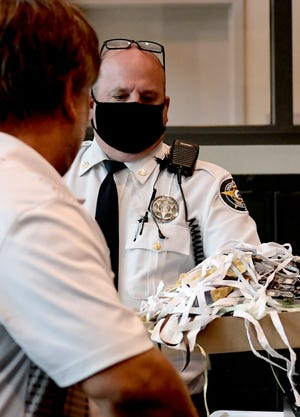 York County Sheriff's Deputy Paul Stoner offers a visitor a mask at the entrance to the building Tuesday, June 23, 2020. Thermal 213 devices are in use at the York County Courthouse. The device, funded with CARES Act money, uses thermal imaging to detect body temperature. Bill Kalina photo