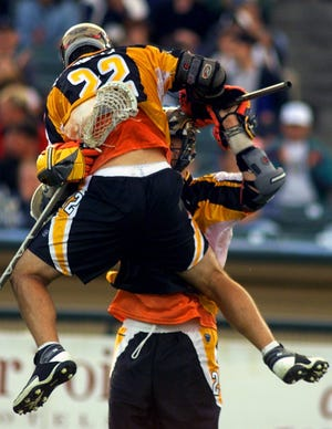 Ryan Powell (22) celebrates a goal with John Grant Jr. in the Rochester Rattlers home debut at Frontier Field in June 2001.
