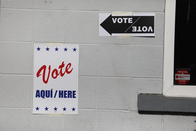Signs guiding voters are placed around the entrance at The Community Place of Greater Rochester on Parsells Avenue on Tuesday, June 23, 2020.