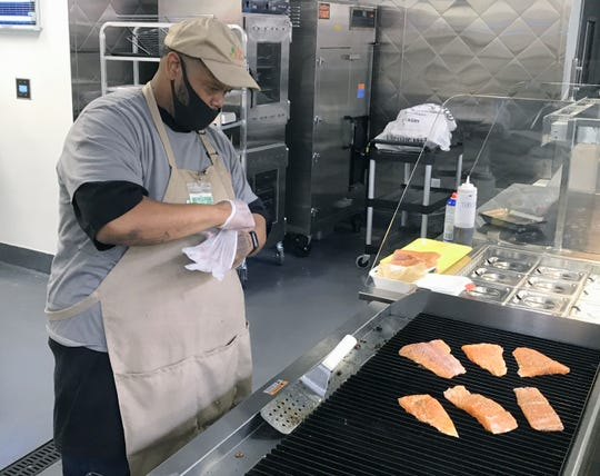 William Moore is one of four grillmasters at Save Mart in south Redding. He was grilling salmon on Tuesday, June 23, 2020, in preparation for the store's upcoming opening.