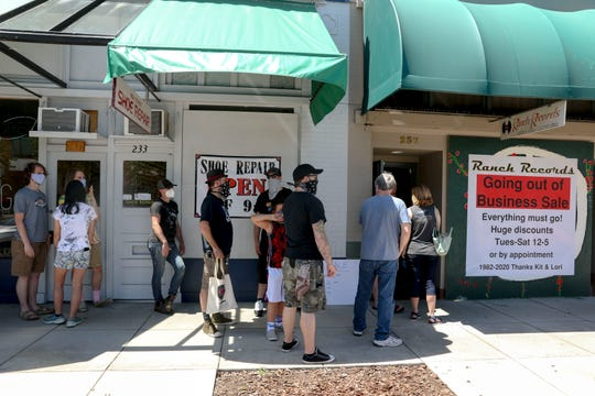 People line up to enter Ranch Records for the going out of business sale in Salem, Oregon, on Tuesday, June 23, 2020. The record store is closing after nearly 40 years in business.