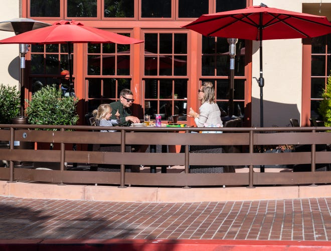 A family eats at a restaurant as Monterey County reopens people amid a spike in COVID-19 cases in June, 2020.